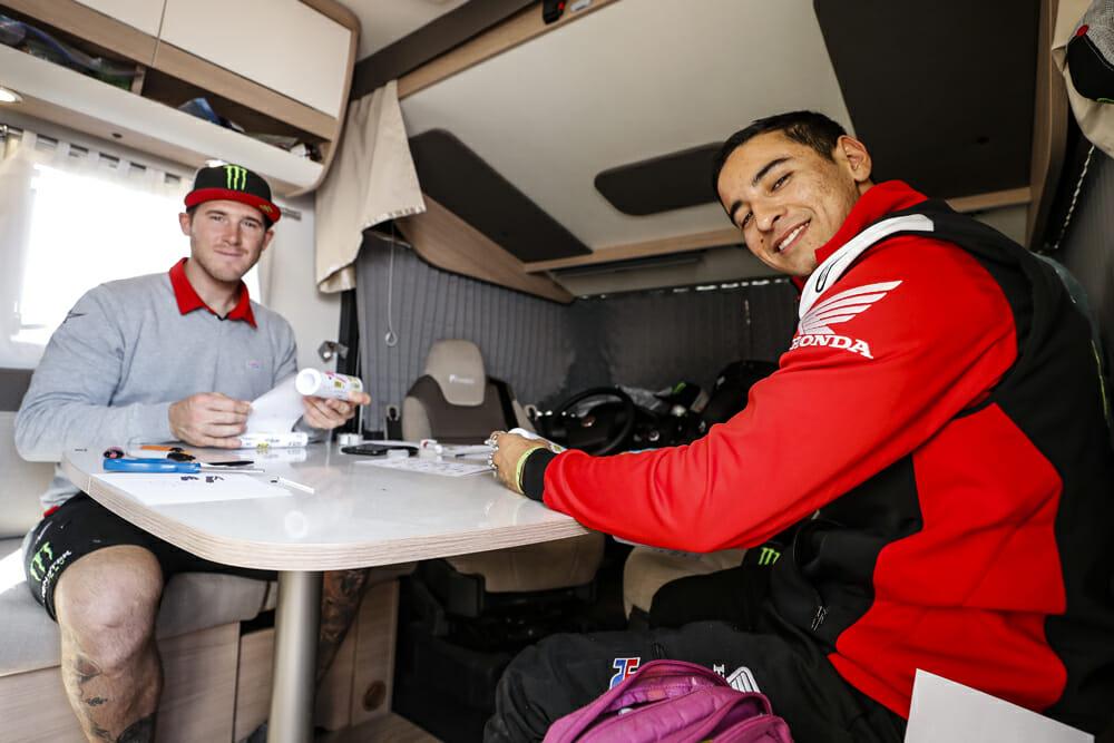 Ricky Brabec reviews the Dakar Rally roll chart with his Monster Energy Honda teammate Nacho Cornejo.