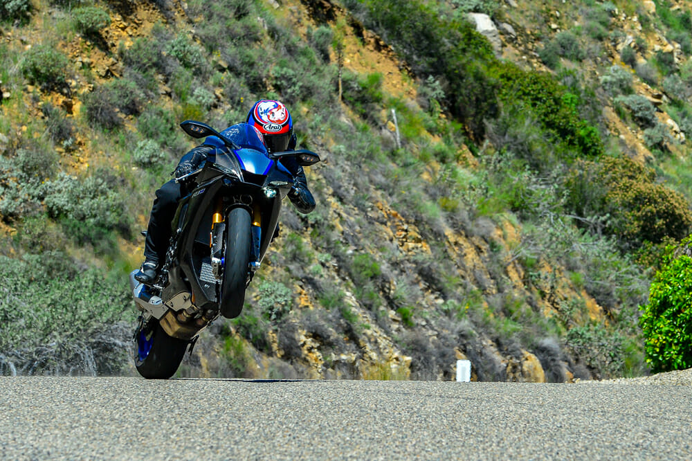 The 2020 Yamaha YZF-R1M's wheelie control allows you to carry a little wheelie and style it for the camera.