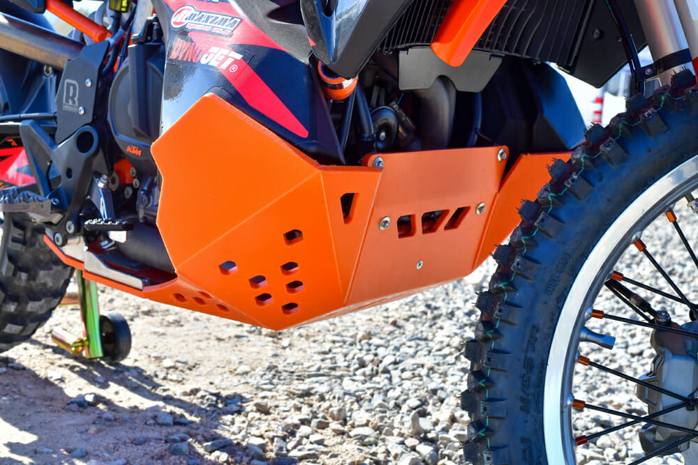 The bottom of the Rottweiler Performance KTM 790 Adventure R's fuel cell is encapsulated in the skid plate, as is the whole undercarriage.