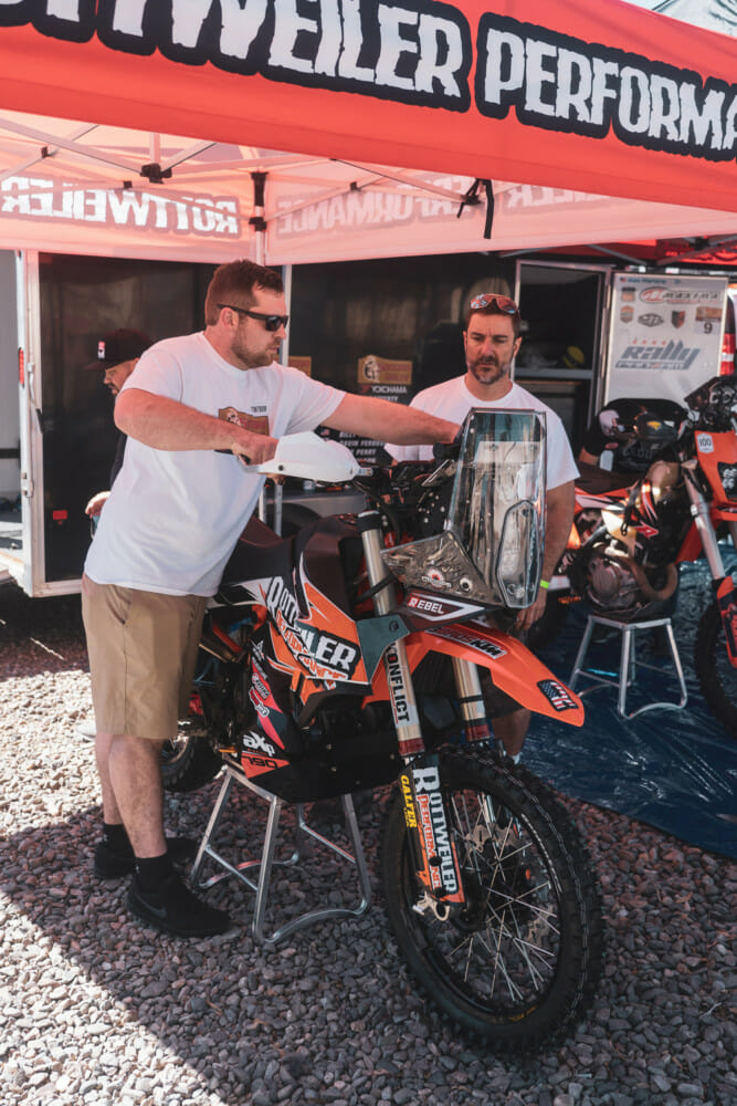 Wes Vannieuwenhuise (left) and bike builder Chris Parker get ready for another Sonora stage.