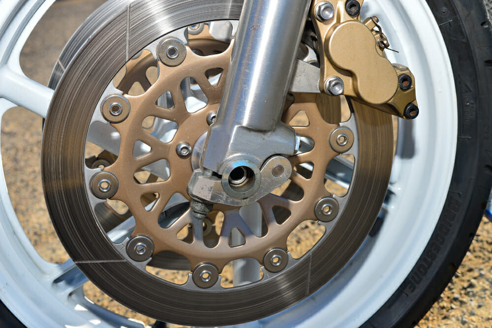 Quick-release axles on the 1990 Honda RC30's front wheel.