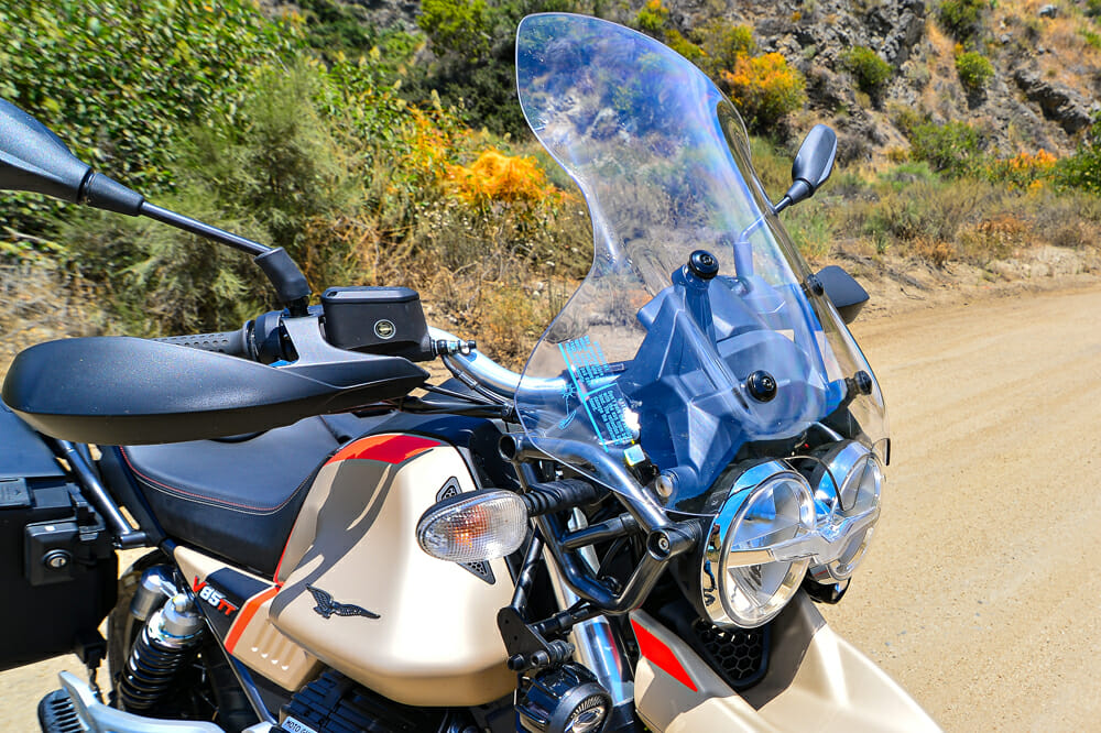 Larger screen, heated grips and fog lights are part of the touring package for the 2020 Moto Guzzi V85 TT Travel touring bike.