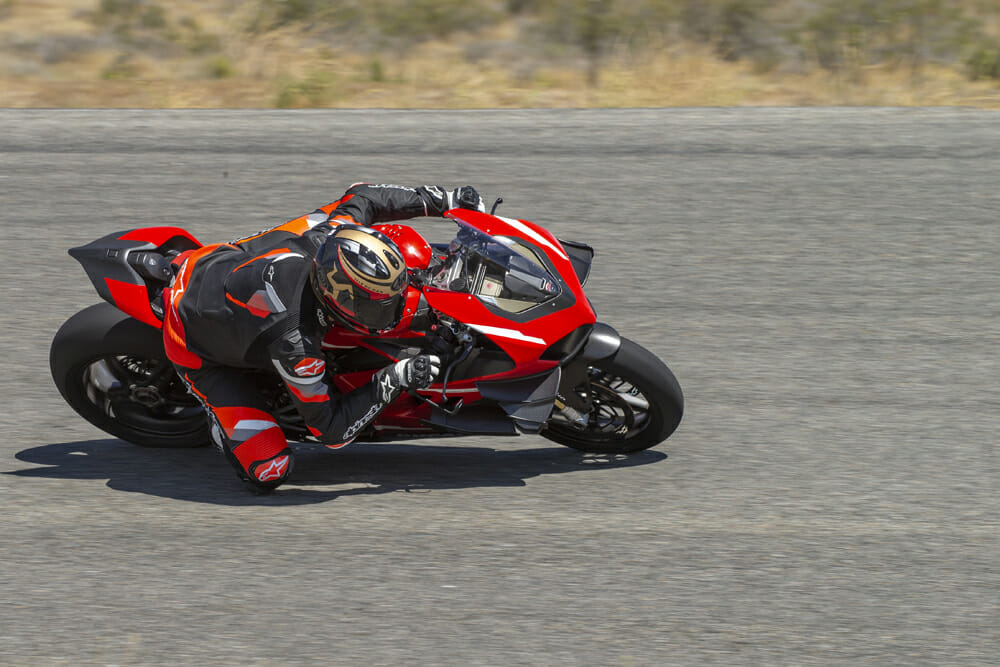 A 2020 Ducati Superleggera V4 at full lean on the racetrack.