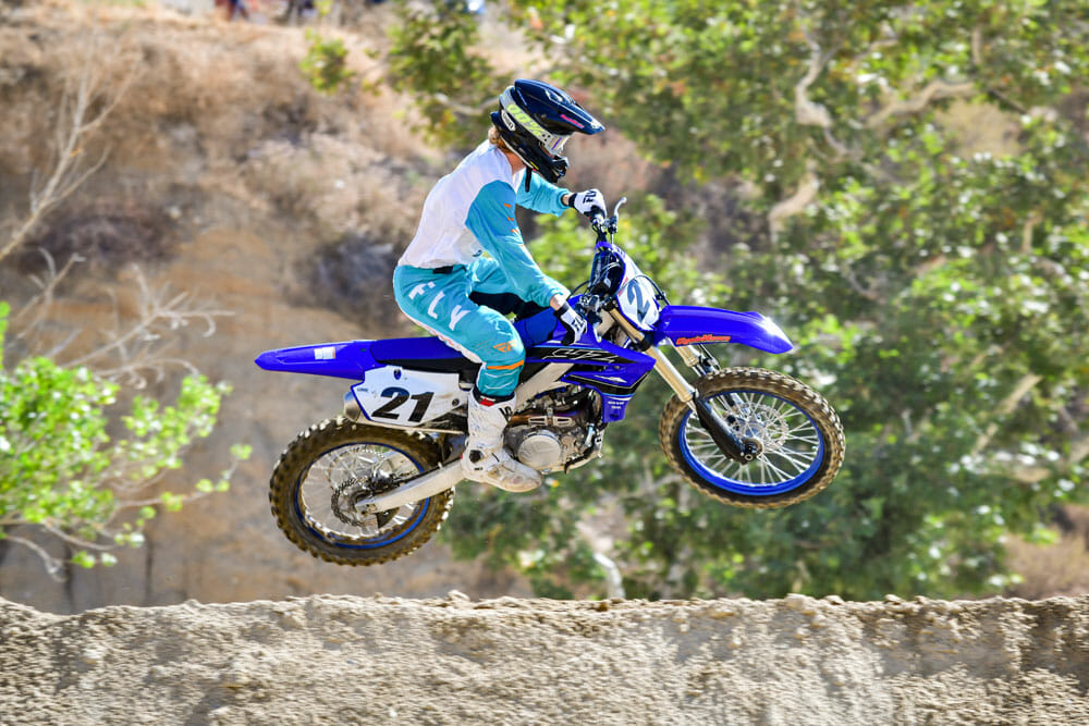 The 2021 Yamaha YZ450F in a big jump.