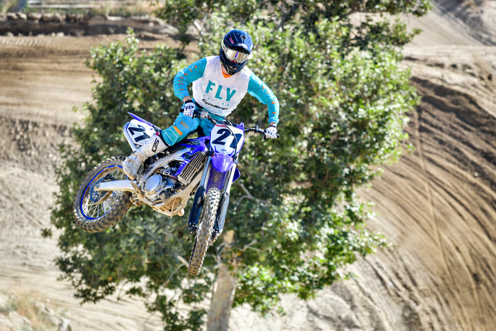 The 2021 Yamaha YZ450F jumping.