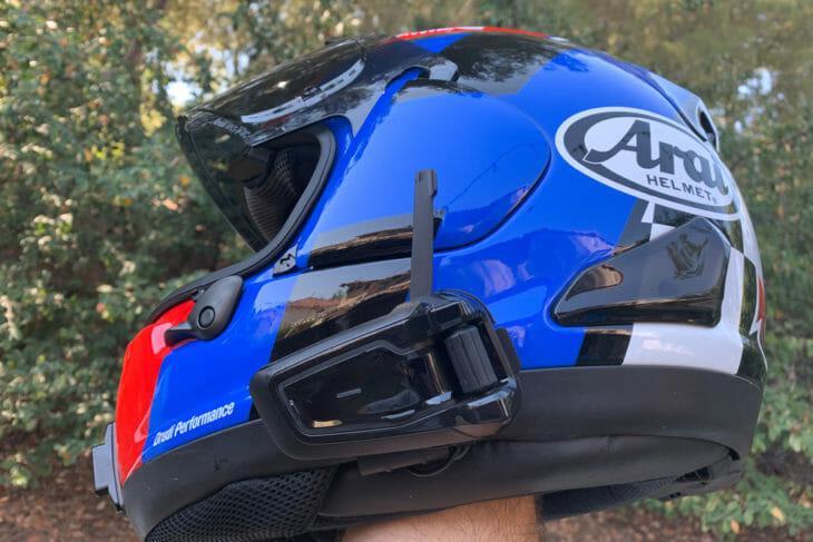 Cardo Packtalk Black on a blue Arai helmet